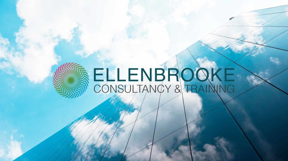 View of glass building and sky behind the Ellenbrooke logo